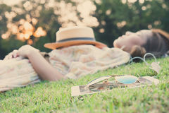 Young woman taking a nap in park Stock Images