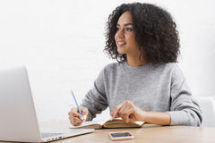 Young woman taking notes royalty free stock photography