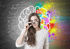 Young woman taking off glasses, brain, formulas Stock Photography