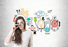 Young woman taking off glasses, startup sketch Royalty Free Stock Photo