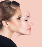 Young woman taking off a mask Royalty Free Stock Image