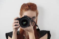 Young woman taking a photo Royalty Free Stock Photo