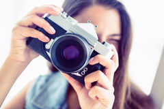 Young woman taking a photo Stock Photo
