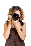 Young woman taking a photo with a camera Royalty Free Stock Photography