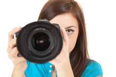 Young woman taking a photo with a digital camera Royalty Free Stock Photo