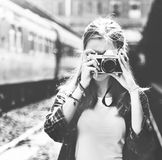 Young woman is taking photo with film camera royalty free stock photo