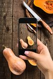A young woman taking photo of food on smartphone, photographing meal with mobile camera Stock Images