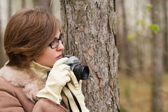 Young woman taking photo in the forest Royalty Free Stock Photography