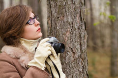 Young woman taking photo in the forest Stock Photography