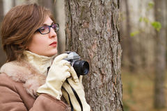 Young woman taking photo in the forest Stock Photos