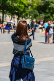 Young woman taking a photo Stock Photography