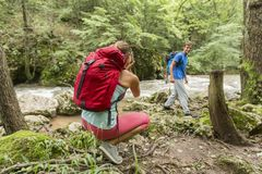 Young woman taking photo of man at hiking Royalty Free Stock Images