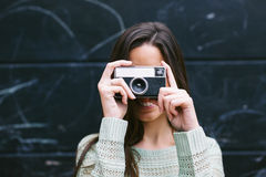 Young woman taking a photo with an old camera. Royalty Free Stock Photo