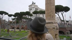Young woman taking photo of the Roman Forum with cellphone in Rome, Italy stock video footage