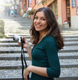 Young woman taking photo in Salita Serbelloni picturesque small town street view in Bellagio, Lake Como, Italy Royalty Free Stock Images
