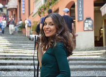 Young woman taking photo in Salita Serbelloni picturesque small town street view in Bellagio, Lake Como, Italy.  stock photo