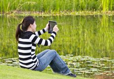 Young woman taking photographs Royalty Free Stock Images