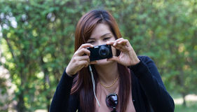 young woman taking photos Royalty Free Stock Image