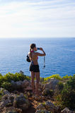 Young woman is taking photos  - Keri, Zakynthos, Greece Stock Photos