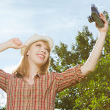 Young woman taking photos Stock Image