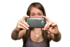 Young woman is taking photos with the mobile phone camera Stock Images