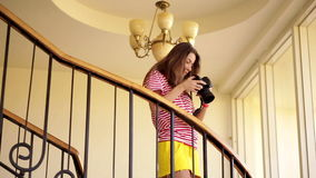 Young woman taking a pic stock video