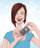 Young woman taking a picture Royalty Free Stock Images