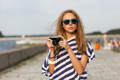 Young woman taking a picture Stock Photos