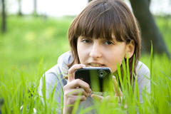 Young woman taking picture with digital camera Royalty Free Stock Images