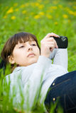 Young woman taking picture with digital camera Stock Photos