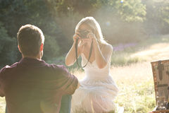 A young woman taking a picture of her boyfriend Stock Photo