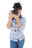 Young woman taking picture with her camera Stock Photos