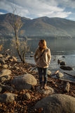 Young woman taking picture by the lake Royalty Free Stock Photography