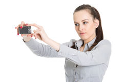 Young woman taking picture with mobile phone Royalty Free Stock Photography
