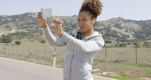 Young woman taking picture of nature Stock Photos