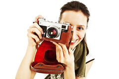 Young woman taking a picture with an old camera Stock Photography