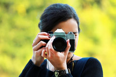 Young woman taking a picture Royalty Free Stock Photography