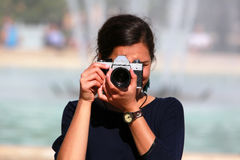 Young woman taking a picture Stock Photo