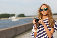 Young woman taking a picture Royalty Free Stock Image