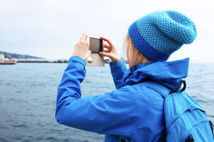 Young woman taking picture with smartphone. Stock Photo