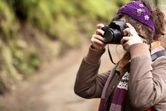 Young woman taking pictures Royalty Free Stock Photography