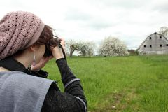 Young woman taking pictures Royalty Free Stock Images