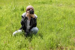 Young woman taking pictures Stock Photography