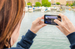 Young Woman Taking Pictures from the Deck of a Ship Royalty Free Stock Photos