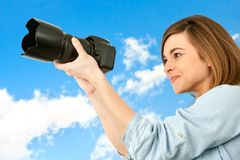 Young woman taking pictures outdoors. Royalty Free Stock Photo