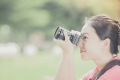 A young woman taking pictures outdoors Royalty Free Stock Photography