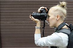 Young woman taking pictures. Stock Photo