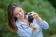 Young woman taking pictures. A young woman taking some pictures Royalty Free Stock Images