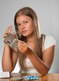 Young woman taking a pill Royalty Free Stock Photography