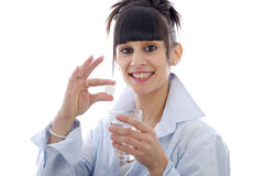 Young woman taking a pill, on white Royalty Free Stock Photography